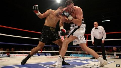 Neven Pajkic and Tyson Fury during their Commonwealth heavyweight title fight in Manchester