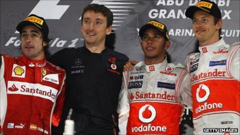Lewis Hamilton (second right) with Andy Latham (second left) of McLaren, Fernando Alonso (left) and Jenson Button