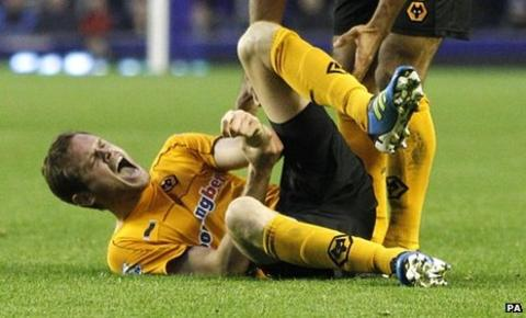 Wolves defender Richard Stearman writhes in agony after suffering an injury