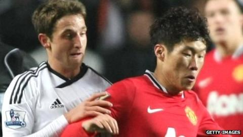 Joe Allen challenges Park Ji-Sung during Swansea City's 0-1 loss to Manchester United