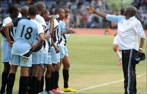Botswana coach Stanley Tshosane instructs his players