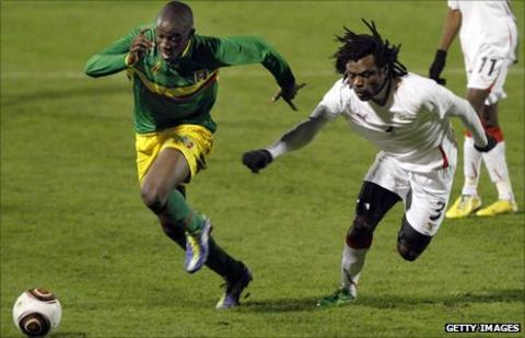 Mali's Cedric Kante (left) and Burkina Faso's Herve Zengue (right)