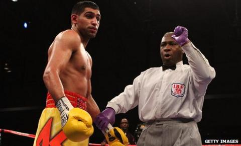 Amir Khan is deducted a point by referee Joseph Cooper