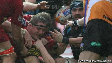 Scarlets prop Rhys Thomas celebrates his try against the Ospreys in the Pro12 west Wales derby