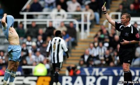 Graham Poll shows Joey Barton a yellow card