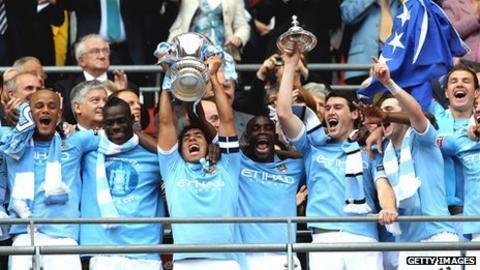 Carlos Tevez lifts the FA Cup following Man City's win over Stoke in last season's final