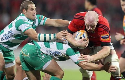 Franco Sbaraglini and Tobias Botes of Treviso combine in an attempt to stop Munster's Paul O'Connell