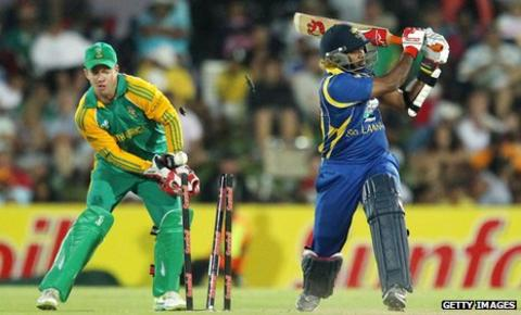 Sri Lanka's Lasith Malinga is bowled, watched by South Africa captain AB de Villiers