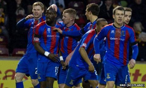 Gregory Tade celebrates with his Inverness team-mates after scoring against Motherwell