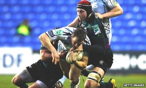 Cardiff Blues' Sam Warburton is tackled by London Irish's Nick Kennedy