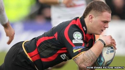Rhys Buckley goes over for the Dragons