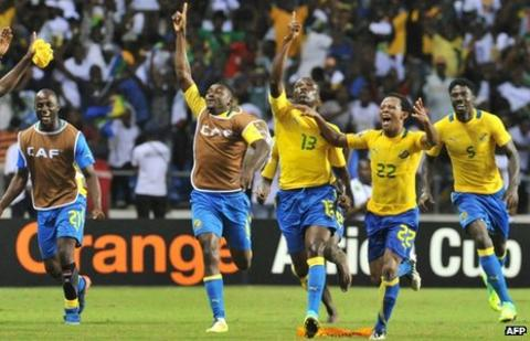 Gabon players celebrate their dramatic win over Morocco