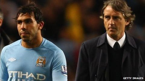 Manchester City striker Carlos Tevez and manager Roberto Mancini