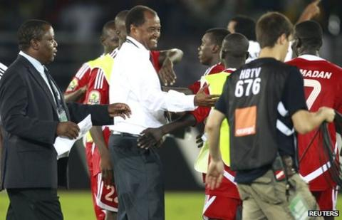 Sudan coach Mohamed 'Mazda' Abdallah celebrates with his players