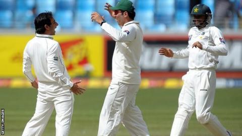 Pakistan's Saeed Ajmal, captain Misbah-ul-Haq and Azhar Ali celebrate a wicket