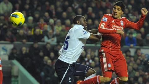 Luis Suarez beats Ledley King to a header