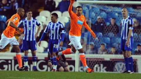 Matt Phillips celebrates Blackpool's opener