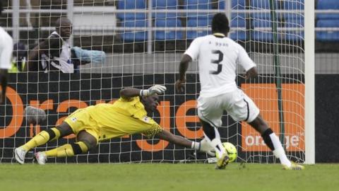Zambia's Kennedy Mweene saves a penalty from Asamoah Gyan in Bata