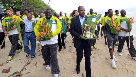 Zambian players and officials visit the site close to the crash in Libreville