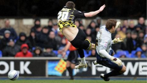 Joe Mason of Cardiff City is fouled by Ipswich goalkeeper Arran Lee-Barrett