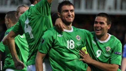 Aaron Hughes with Northern Ireland's record goalscorer David Healy