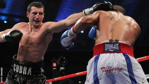 Britain's Carl Froch (left) in action against Andre Ward