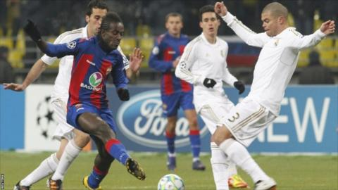 CSKA Moscow's Seydou Doumbia (second left) fights for the ball with Real Madrid's Pepe (right) during their Champions League last 16 match at the Luzhniki stadium in Moscow