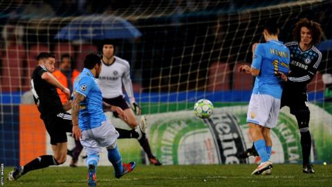 Ezequiel Lavezzi of Napoli shoots past the tackle from Gary Cahill of Chelsea to level the scores at 1-1 in the first half