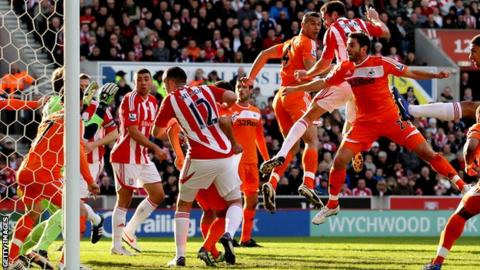 Stoke City's Matthew Upson opens the scoring against Swansea City