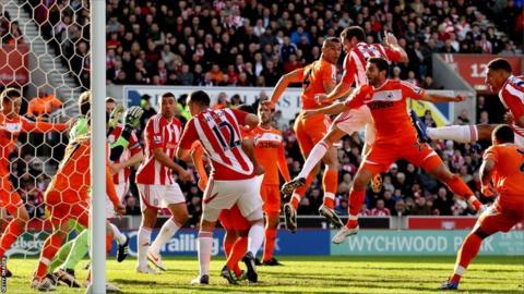 Matthew Upson of Stoke celebrates after scoring their first goal