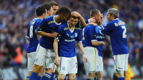 Joe Mason of Cardiff City (centre) celebrates with team mates after he scores their first goal