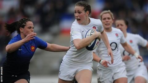 Emily Scarratt of England tries to break away as Elodie Poublan of France goes in for the tackle during the Womens RBS Six Nations match between France and England at Stade Charlety