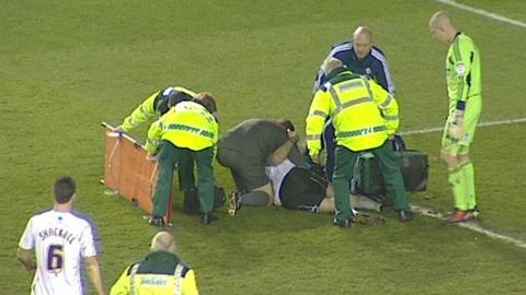 Derby County's Shaun Barker is treated after suffering a serious knee injury in the game against Nottingham Forest