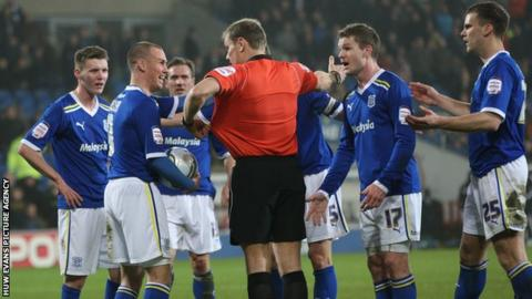 Cardiff City players surround the referee after Ben Turner's disallowed goal
