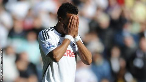 Scott Sinclair shows his disappointment after missing a penalty against Manchester City