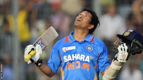 Sachin Tendulkar celebrates scoring his 100th international century
