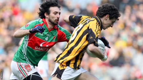 Jamie Clarke attempts to speed away from Tom McHugh at Croke Park