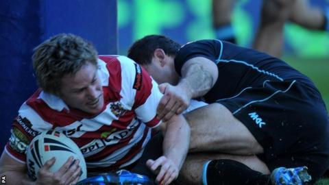 Wigan Warriors' Brett Finch is tackled by London Broncos' Chad Randall but still scores a try