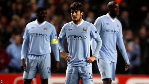David Silva (centre), Kolo Toure (left) and Yaya Toure look dejected