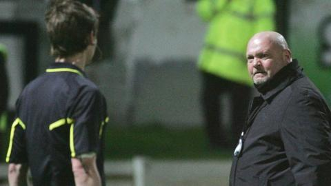 A match official discusses a decision with David Jeffrey during the Brandywell game