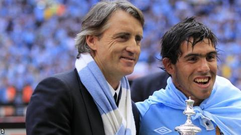Roberto Mancini and Carlos Tevez celebrate after winning the FA Cup in 2011