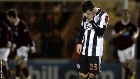 St Mirren's Graham Carey hangs his head at the final whistle, having missed an early penalty