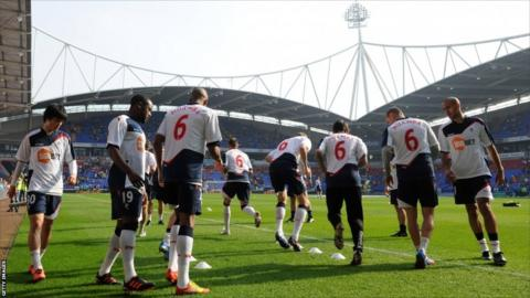 The Bolton players warm up at the Reebok Stadium