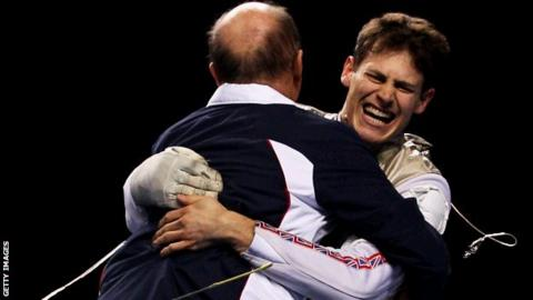 Richard Kruse hugs his coach at the Olympic test event