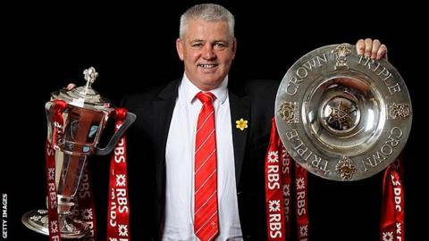 Warren Gatland with the 2012 Six Nations and Triple Crown trophies