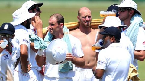 England players take a break during the tour match against the Sri Lankan development XI