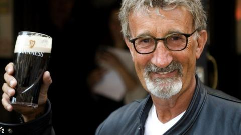 Eddie Jordan enjoys a pint of Guinness at the Toucan Bar in Soho, London, after learning he is to be made an Officer of the British Empire (OBE) in recognition for his services to charity and motor racing.