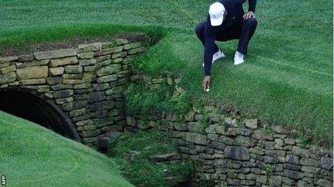 Tiger Woods in a spot of bother on the 13th hole