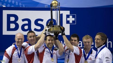 Canada celebrate with the trophy after their win against Scotland in the final of the World Men's Curling Championship