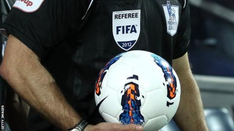 Referee holding a ball